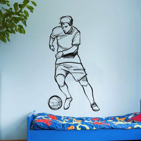 voetballer-muursticker-zwart-lopent-dribbelen-schieten
