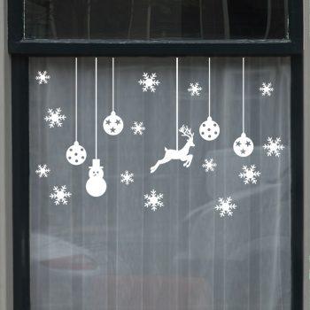 kerst raamstickers wit zwart sneeuw ballen sterren arreslee rendier